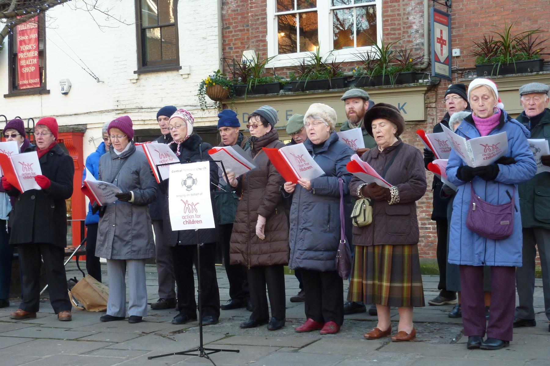 Carol singing in King's Square